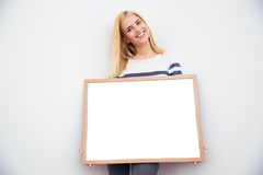 Casual businesswoman holding blank board Stock Photo