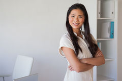 Casual businesswoman looking at camera with arms crossed Royalty Free Stock Image