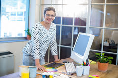Casual businesswoman looking at camera Stock Image