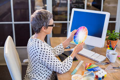 Casual businesswoman looking at colour chart Royalty Free Stock Photo