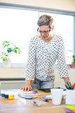 Casual businesswoman looking at colour chart Royalty Free Stock Photos