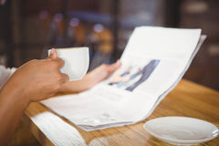 Casual businesswoman looking at files. In a cafe Stock Images