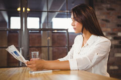 Casual businesswoman looking at files. In a cafe Royalty Free Stock Photography