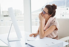 Casual businesswoman looking very tired Royalty Free Stock Image