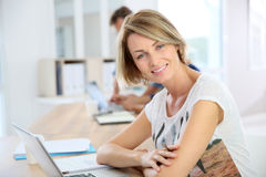 Casual businesswoman at office Stock Photos