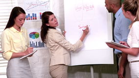 Casual businesswoman presenting her ideas stock video