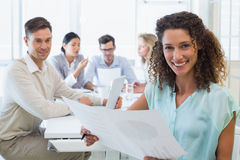 Casual businesswoman reading document during meeting Stock Photography