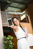Casual businesswoman showing cellphone stock photo