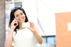 Casual businesswoman showing visiting card Stock Photography