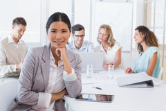 Casual businesswoman smiling at camera during meeting Royalty Free Stock Images