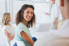 Casual businesswoman smiling at colleague during meeting Royalty Free Stock Image