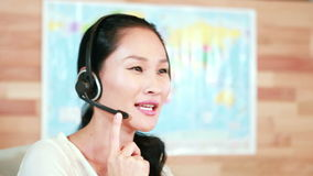 Casual businesswoman speaking with headset. In 4k stock video