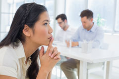 Casual businesswoman thinking during a meeting Stock Images