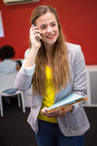Casual businesswoman using cellphone in office Stock Photography
