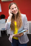 Casual businesswoman using cellphone in office Royalty Free Stock Photos