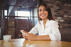 Casual businesswoman using her phones Royalty Free Stock Photo