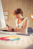 Casual businesswoman using her smartphone Royalty Free Stock Photo