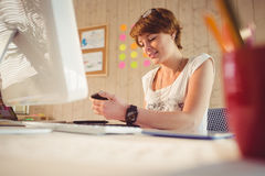 Casual businesswoman using her smartphone Stock Photo