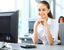 Casual businesswoman using laptop in office Royalty Free Stock Photography