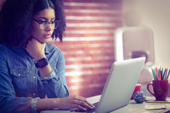 Casual businesswoman using laptop and smartwatch Royalty Free Stock Photography