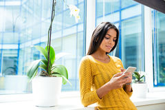 Casual businesswoman using smartphone Stock Photography