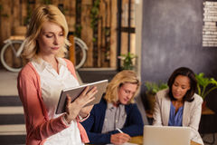 Casual businesswoman using a tablet computer Stock Photography