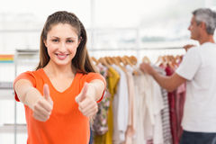Casual businesswoman volunteering and doing thumbs up Royalty Free Stock Photography