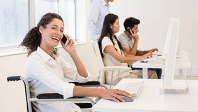 Casual businesswoman in wheelchair on the phone smiling at camera Stock Images