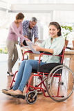 Casual businesswoman in wheelchair using tablet Stock Photography