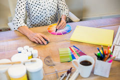 Casual businesswoman working with colour chart Royalty Free Stock Photos