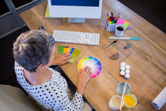 Casual businesswoman working with colour chart Royalty Free Stock Photography