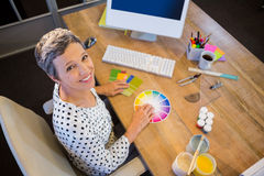 Casual businesswoman working with colour chart Stock Photography