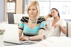 Casual businesswoman working with laptop computer Stock Photos
