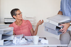 Casual businesswomans workload getting bigger and bigger Royalty Free Stock Image