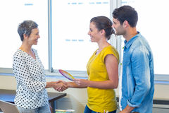 Casual businesswomen shaking hands Stock Images