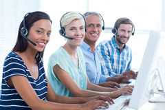 Casual call centre workers looking at the camera Stock Photo