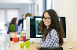 Casual caucasian businesswoman at business startup office with computer, wearing glasses. stock photos