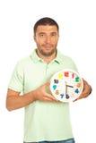 casual clock happy holding man 免版税库存照片