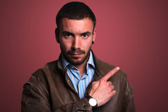 Portrait of a serious man pointing Stock Image