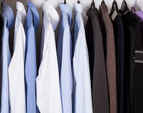 Casual clothes in a wardrobe Stock Image