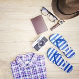 The Casual clothing and accessories on the wooden table background. Casual clothing and accessories on the wooden table background Royalty Free Stock Photos