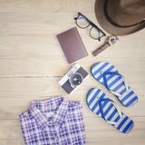 Casual clothing flim camera and accessories on the wooden background. The Casual clothing flim camera and accessories on the wooden background Royalty Free Stock Photo
