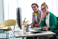 Casual colleagues smiling at camera. In the office royalty free stock photo