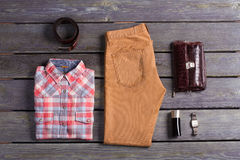 Casual collection of men's clothing. Clothing and accessories on a wooden background Royalty Free Stock Photo