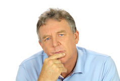 Casual Concerned Man. Casual middle aged man with hand on chin with a concerned look Stock Image