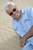Casual Confident Senior Man. Relaxing on a sand dune Royalty Free Stock Photos
