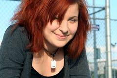 Casual Contemporary Teen. Smiling contemporary teen girl, taken outdoors stock photography