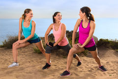 Casual conversation athletes stretching in exercise class outdoors before jog and hike on trail path royalty free stock image