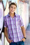 Casual cool guy. Young guy leaning on graffiti wall Royalty Free Stock Photo