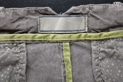 Casual cotton men's trousers. Detail of gray casual cotton men's trousers Stock Photos